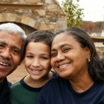 Minority couple with their grandson at their home